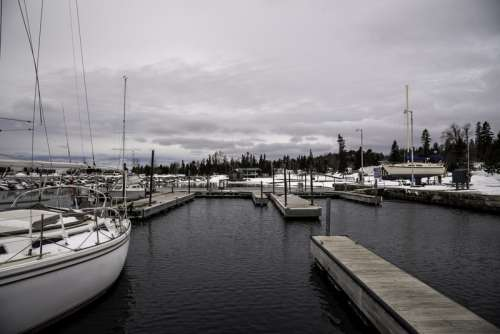 Docks, ships, and landscape in the winter in Grand Marais, Minnesota free photo