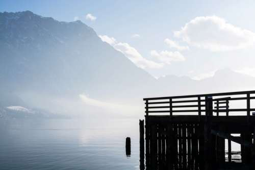 Docks with mountains in the background in Toskana Park Gmunden Gmunden Austria free photo