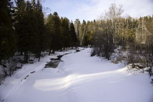 Downstream with snow and ice on the Gooseberry River at Gooseberry falls State Park, Minnesota free photo