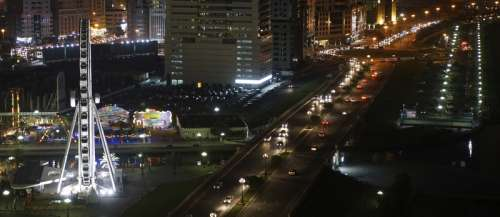 Eye of the Emirates and the Al Qasba Canal by night in Sharjah, United Arab Emirates free photo