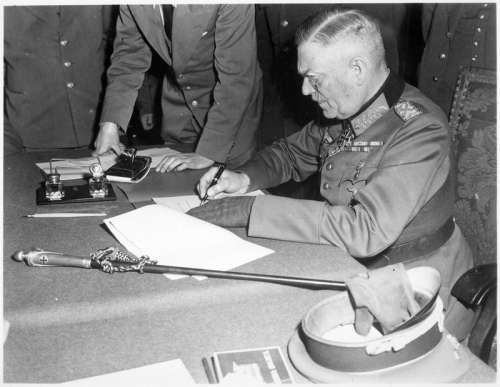 Field Marshall Wilhelm Keitel signs the final surrender terms, Victory in Europe free photo