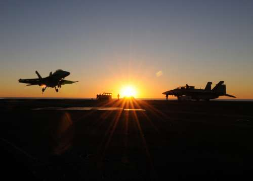Fighter jets landing at sunset free photo