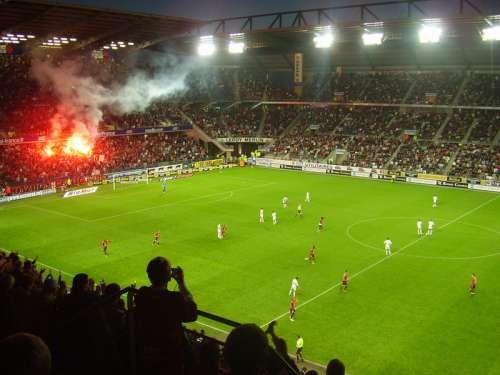Flares of the Roazhon Celtic Kop at the Roazhon Park in Rennes, France free photo