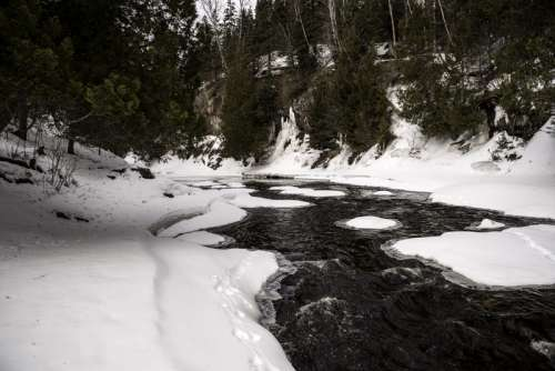 Flowing Cascade River in the winter at Cascade River State Park, Minnesota free photo