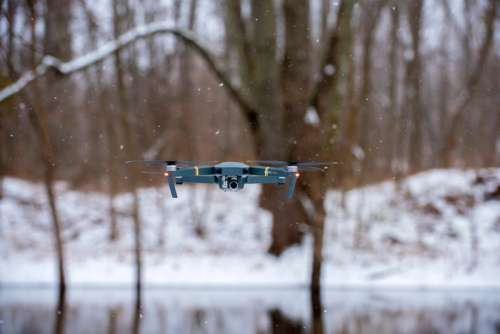 Flying Drone in the Snow free photo
