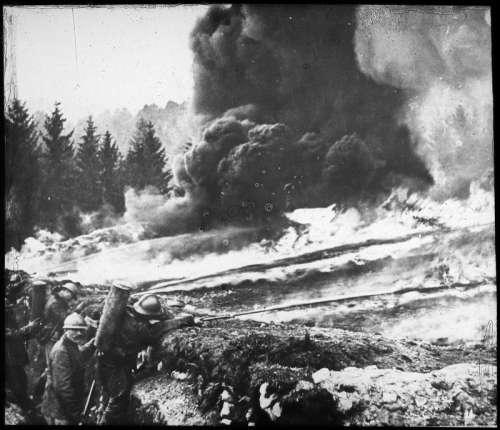 French soldiers making a gas and flame attack on German trenches in World War I free photo