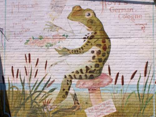 Frog Sitting on a chair Mural in Rayne, Louisiana free photo