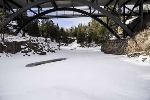 Frozen Gooseberry River Under the Bridge at Gooseberry Falls State Park, Minnesota free photo