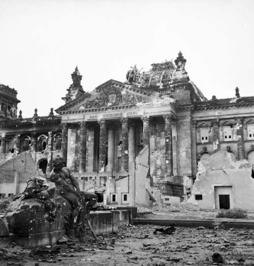 The German Reichstag after its capture by the Allies in World War II free photo
