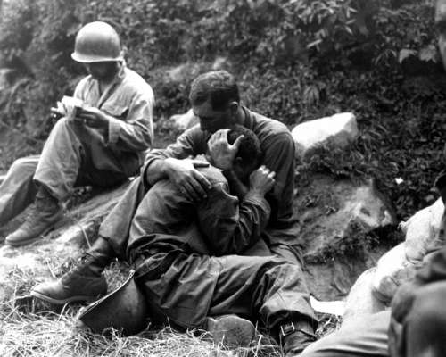 G.I. comforting a grieving infantryman in Korean War free photo
