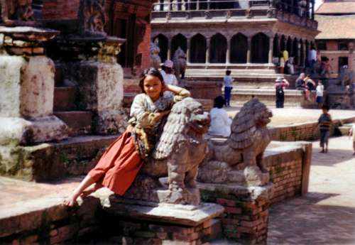 Girl Leaning on a statue in Kathmandu, Nepal free photo