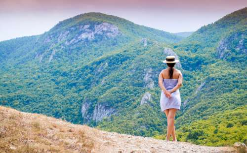 Girl looking at mountains landscape free photo