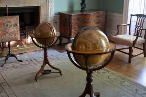 Globes sitting in a room free photo