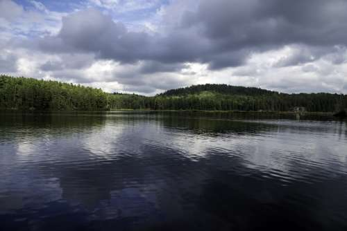 Great Skies and landscape with water reflections at Algonquin Provincial Park, Ontario free photo