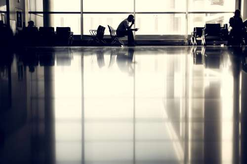 A guy waiting at the airport free photo