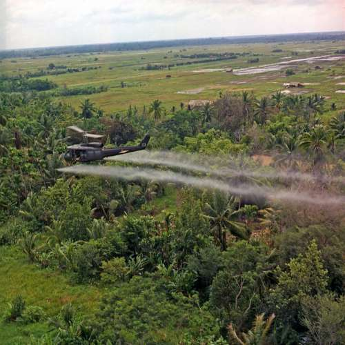 Helicopter spraying chemical defoliants in Vietnam free photo