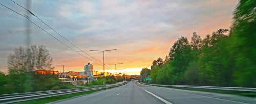 Highway and road into the sunset in town free photo