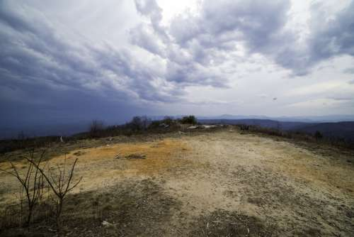 Hilltop landscape under the sky and clouds at Sassafras Mountain, South Carolina free photo