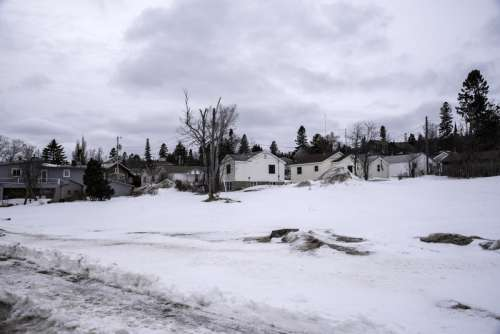 Houses and village in the snow in Grand Marais, Minnesota free photo