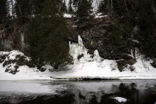 Icicles forming on the banks at Cascade River State Park, Minnesota free photo