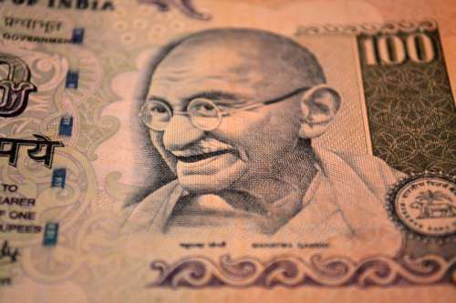 Indian Money with Ghandi on the bill free photo