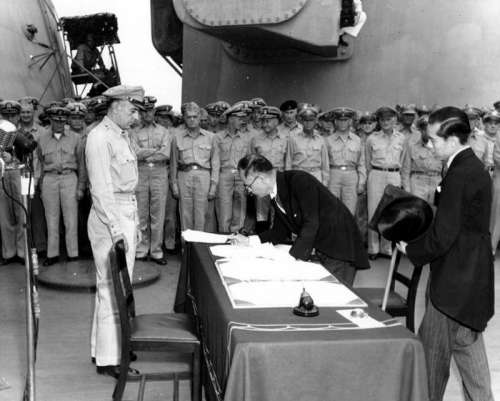 Japanese foreign affairs minister signing Japanese Surrender of World War II free photo