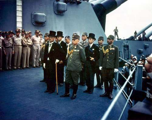 The Japanese representatives aboard the USS Missouri signing Surrender Document free photo