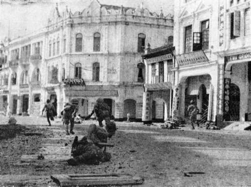 Japanese troops advancing up High Street in 1941 in Kuala Lumpur, Malaysia free photo