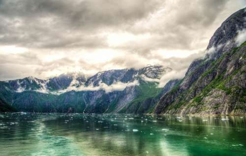 Landscape of mountains and Fjords under clouds around Juneau, Alaska free photo
