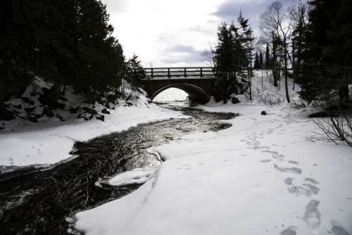 Landscape of the Cascade River as it goes towards the bridge at Cascade River State Park, Minnesota free photo