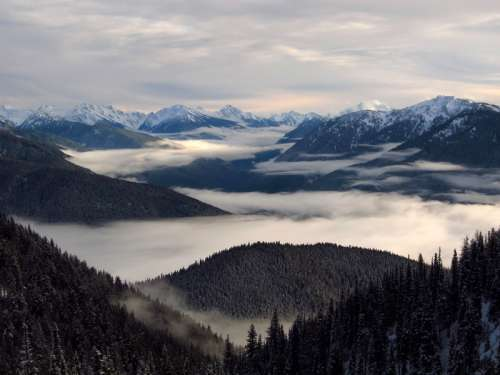 Landscape with clouds and mountaintops in Olympic National Park, Washington free photo