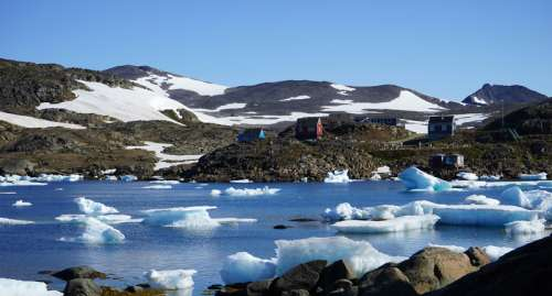 Landscape with hills and lake and ice and house in Greenland free photo