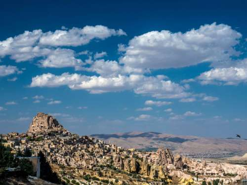 Landscape with houses in stones under sky and clouds in Cappadocia, Turkey free photo