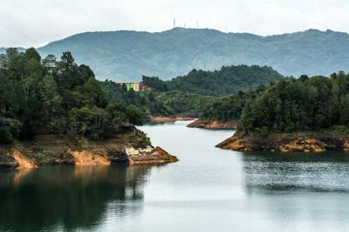 Landscape with river and forest in Guatape, Colombia free photo