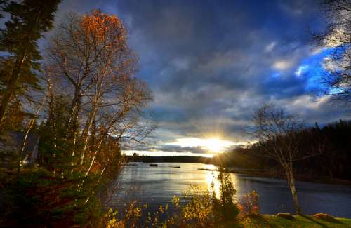 Late Afternoon Lights with clouds and landscape in Quebec, Canada free photo