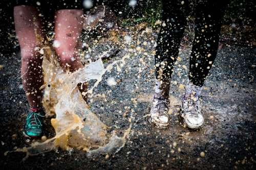 Legs splashing in the rain free photo