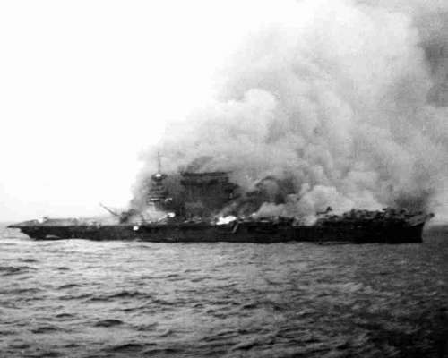 Lexington abandoned and on fire during the Battle of Coral Sea, World War II free photo