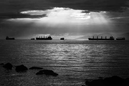 Light on the ocean with ships in Vancouver, British Columbia, Canada free photo