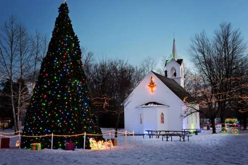 Lights and decorations and tree and church at Christmas free photo