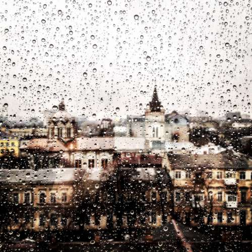 Looking at the cityscape of Odessa through a rainy window in Ukraine free photo