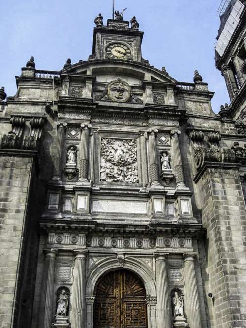 Main portal with view of clock at the Mexico City Cathedral free photo