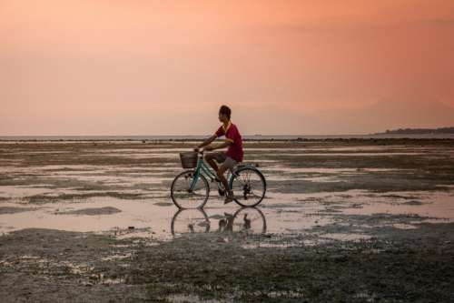 Man on Bicycle in Indonesia free photo