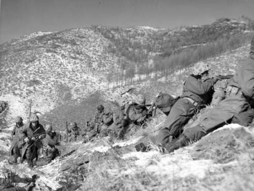 Marines taking cover at the Battle of Chosin Reservoir, Korean War free photo