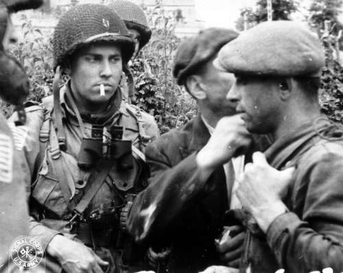 Members of the French Resistance and the U.S. 82nd Airborne division in World War II free photo