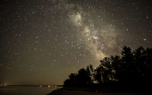Milky Way Beyond the Trees in Bayfield, Wisconsin free photo