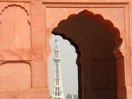 Minar-e-Pakistan richly framed by an aisle arch in Lahore free photo