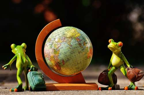 Miniature Globe with two frogs free photo