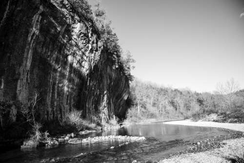 Monochrome photo of current river and cliff at Echo Bluff State Park, Missouri free photo