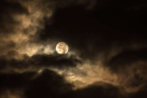 Moon Among the Clouds free photo