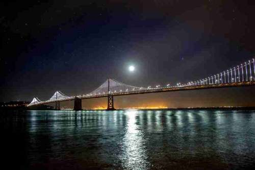 Moon and Stars over the Oakland-San Francisco Bay Bridge at night in California free photo